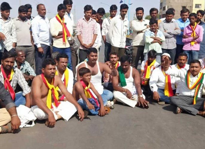 Activists staging sit-in protest in Athani town in Belagavi district during bandh called demanding water release from Maharashtra on Monday.