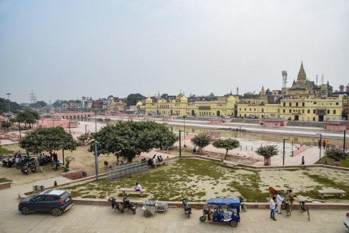 Commuters ride across a street near Ram Ki Paidi area in Ayodhya, Saturday, Oct. 19, 2019. (PTI Photo)