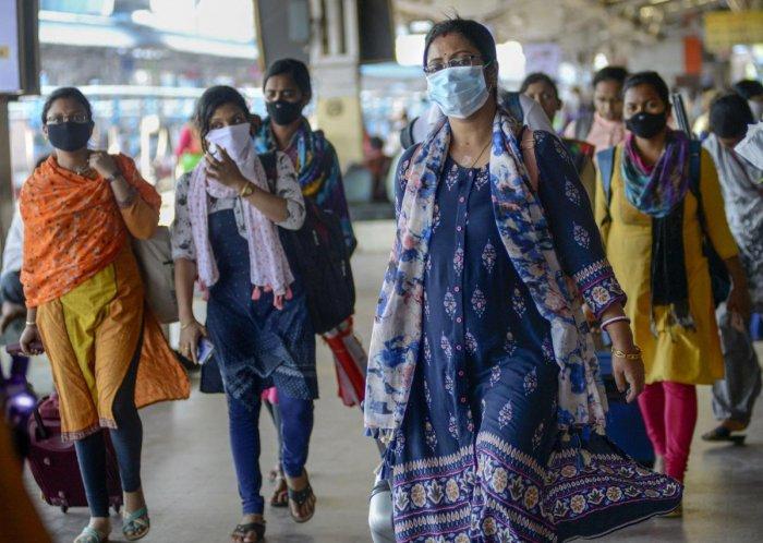 Passengers wear masks as a preventive measure against coronavirus, at Bhubaneswar Railway Station, Monday, March 16, 2020. (PTI Photo)