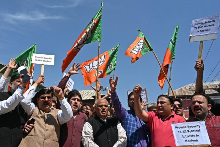 Members of the Indian Bharatiya Janata Party (BJP) take part in a protest to demand heightened security for party workers in Srinagar on May 7, 2019, in the wake of violence against political workers in state. (AFP)