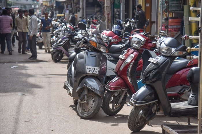 Two wheelers parked two lines at Godown road in Bengaluru. (DH Photo)