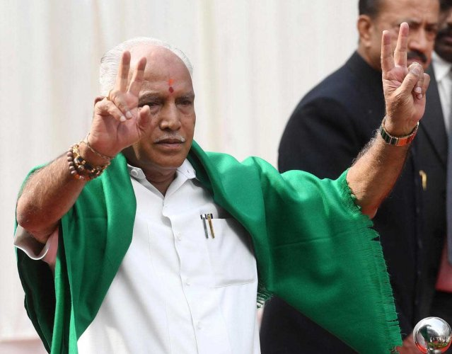 The green shawl was back on his shoulder while Governor Vajubhai R Vala administered the oath of office amid chants of 'Bharat Mata Ki Jai', 'BSY' and 'Modi' at the glass house inside Raj Bhavan.