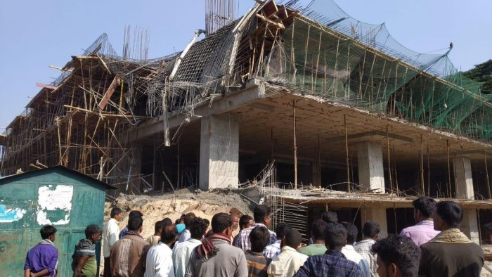 Two labourers were killed and eight of them suffered injuries after the third floor of an under-construction multi-level car parking building in APMC premise in RMC Yard in North Bengaluru, collapsed in the wee hours on Friday. DH photo