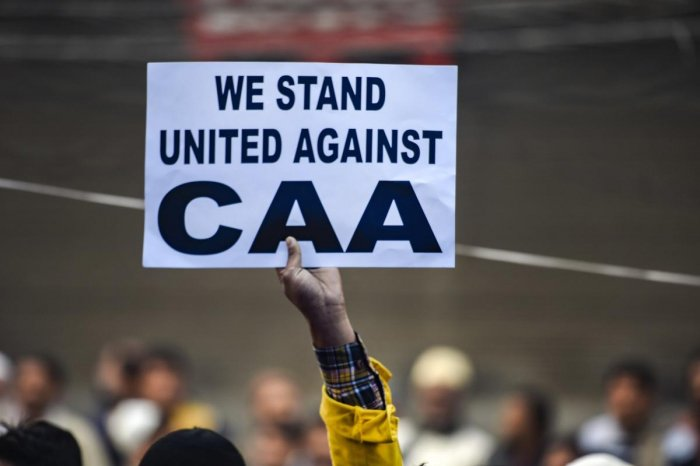 A protestor holds a placard during a demonstration against the Citizenship Amendment Act (CAA). (PTI file photo)