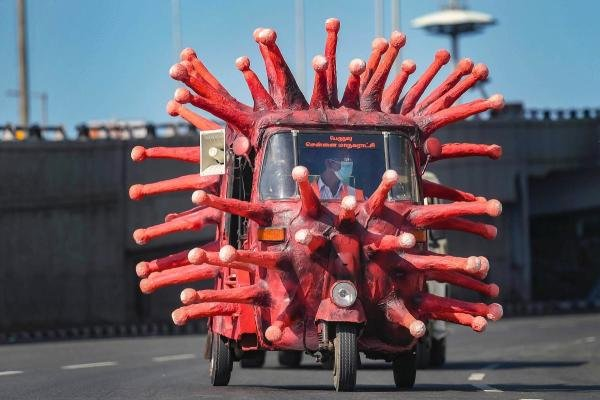 A man drives an auto-rickshaw depicting novel coronavirus to create awareness about the pandemic, during the ongoing COVID-19 lockdown in Chennai. (PTI Photo)