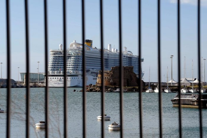 The Costa Smeralda cruise ship is seen behind a fence at it is docked in the Civitavecchia port 70km north of Rome on January 30, 2020. - More than 6,000 tourists were under lockdown aboard the cruise ship after two Chinese passengers were isolated over fears they could be carrying the coronavirus.