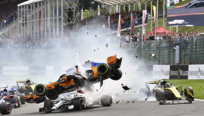 McLaren driver Fernando Alonso is launched into the air after a collision at the start of the 2018 Belgian Grand Prix. Picture credit: AP/ PTI