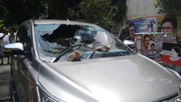 Police sources said Parimalam and his supporters hurled bombs towards his car in which four persons, including those working at Dhinakaran's house, were injured. DH Photo