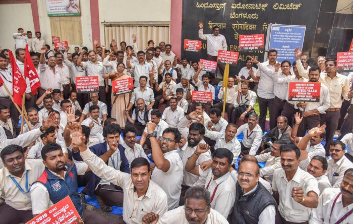 HAL employees, under the banner of the All India HAL Trade Unions Coordination Committee, staged an indefinite strike in front of the factory on Monday. DH Photo/S K Dinesh