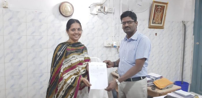 Sneha with her certificate deeming her a 'casteless, religionless' person