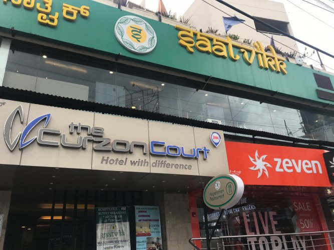 Saattvikk on Brigade Road charges 6%. If customers spot the charge and want it removed, the same is omitted, says the manager.