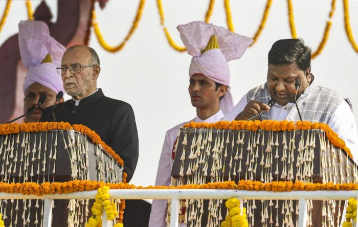 AAP leader Imran Hussain (R) being sworn-in as a Minister in the Delhi Cabinet by Lt Governor Anil Baijal. (PTI Photo)