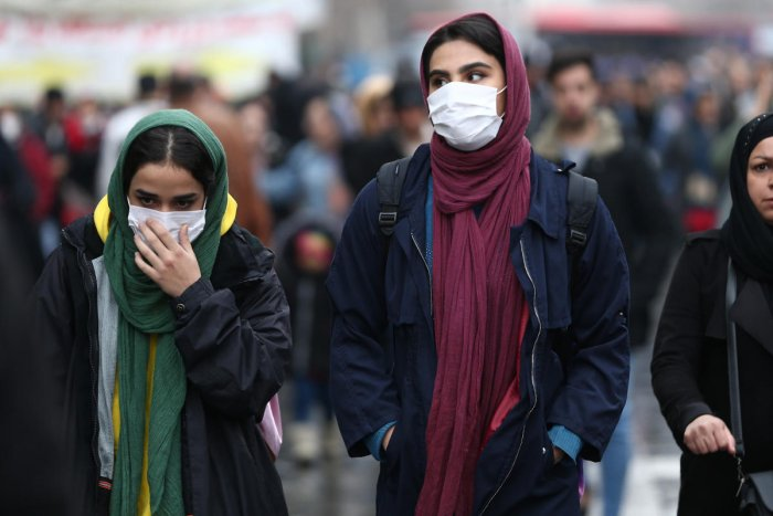 Iranian women wear protective masks to prevent contracting a coronavirus, as they walk at Grand Bazaar in Tehran, Iran February 20, 2020. WANA (West Asia News Agency