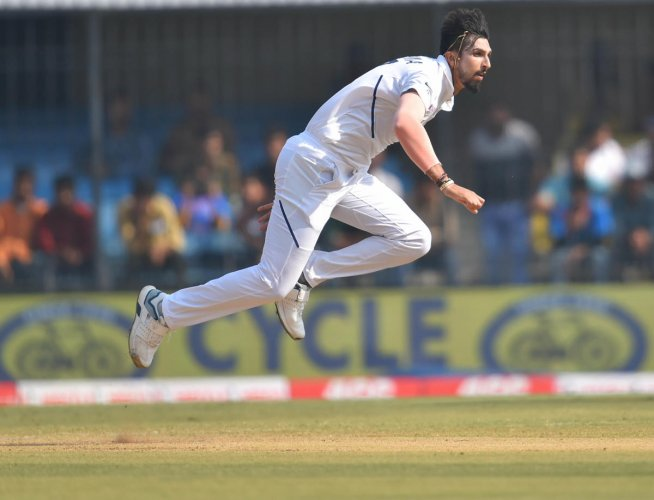 Indian bowler Ishant Sharma in action against Bangladesh on day 3 of their first cricket test match in Indore. PTI