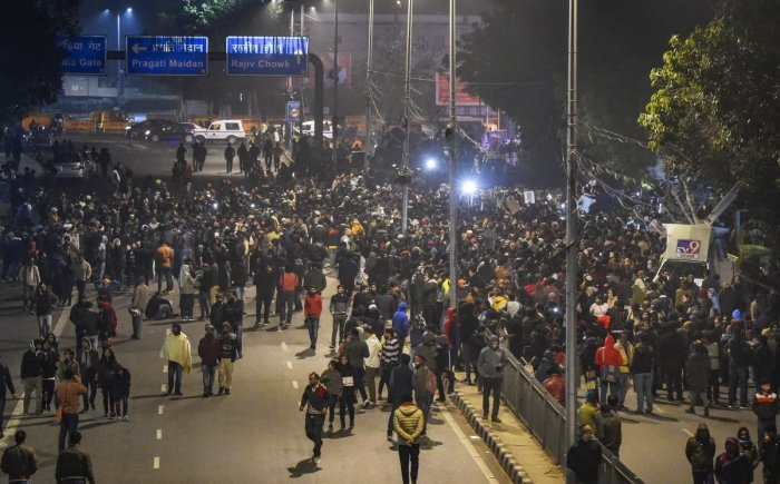In this late Sunday night, Dec, 15, 2019 picture, protestors gather in solidarity with Jamia Millia Islamia as they raise slogans against the police action, at PHQ in New Delhi. (PTI photo)