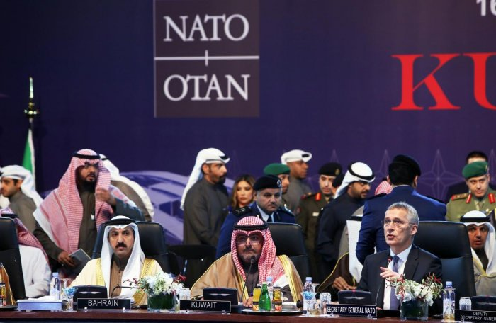 Chairman of Kuwait's national security apparatus (NSA) Sheikh Thamer al-Sabah (C) and NATO Secretary General Jens Stoltenberg (R) attend the NAC-ICI meeting to celebrate the 15th anniversary of the Istanbul cooperation initiative in Kuwait City. AFP
