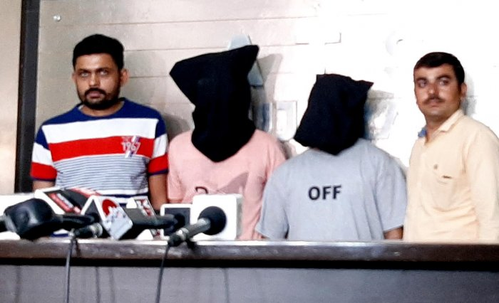 Two suspected persons, Sheikh Ashfaq Hussain and Pathan Moinuddin Ahmed, arrested in connection to the murder of Hindu Samaj Party founder Kamlesh Tiwari arrested from Gujarat-Rajasthan border near Shamlaji, Tuesday, Oct. 22, 2019. (PTI Photo)