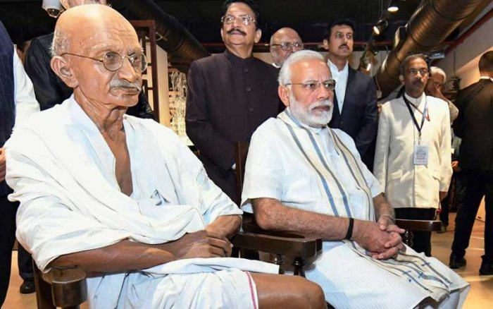 Prime Minister Narendra Modi near the statue of Mahatma Gandhi at newly opened National Museum of Indian Cinema in Mumbai on Jan 19, 2019. (PTI)