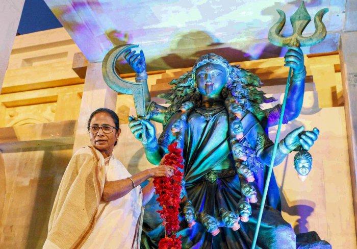 West Bengal Chief Minister Mamata Banerjee inaugurating a Kali Puja pandal at Siliguri in North Bengal, Thursday, Oct. 24, 2019. (PTI Photo)(