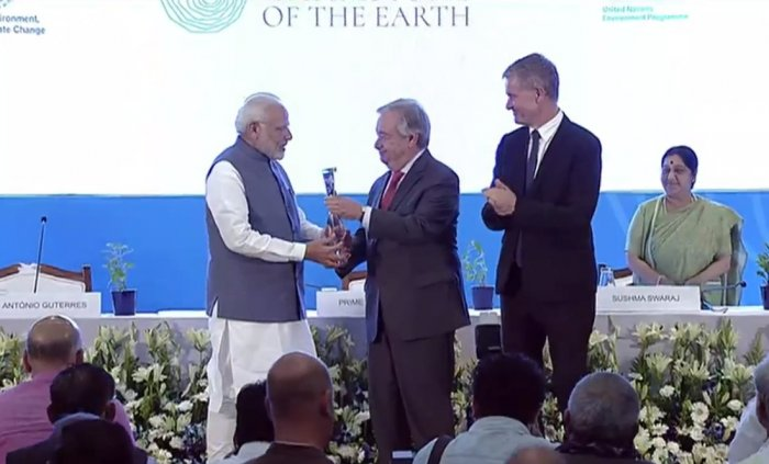 PM Modi receiving the award from the UN Secretary General Antonio Guterres. (Image source: Twitter/BJP4India)