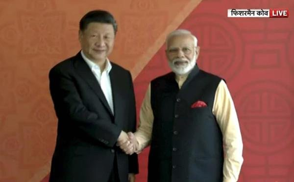 Prime Minister Narendra Modi with Chinese President Xi Jinping, in Mamallapuram. (Video grab/PTI photo)
