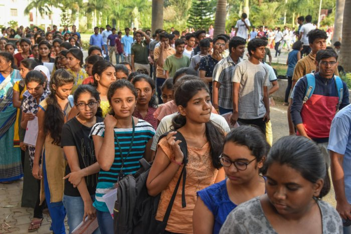 Students after writting National Eligibility Cum Entrance Test (NEET) for admission to MBBS, BDS courses, conducted by National Testing Agency at Army Public School, Kamraj Road in Bengaluru on Sunday. Photo by S K Dinesh