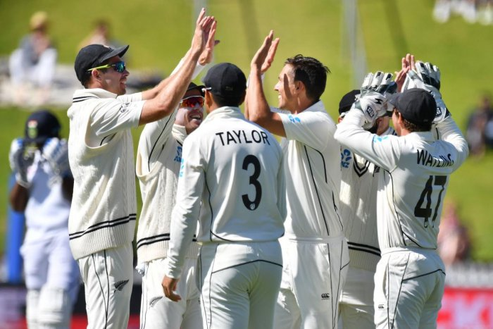 New Zealand's players celebrate bowling India's Ajinkya Rahane during day four of the first Test cricket match between New Zealand and India at the Basin Reserve in Wellington on February 24, 2020. (Photo by Marty MELVILLE / AFP)