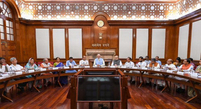 Prime Minister Narendra Modi with Union Ministers Nitin Gadkari, Rajnath Singh, Amit Shah, Nirmala Sitharaman and others during the first cabinet meeting, at the Prime Minister's Office, in South Block, New Delhi, May 31, 2019. (PTI Photo)