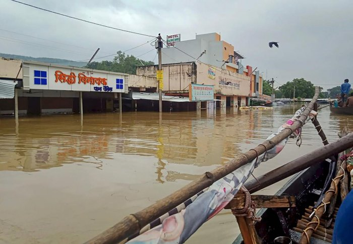 A view of buildings submerged in flood waters following heavy monsoon rainfall, in Neemuch district of Madhya Pradesh, Sunday, Sept. 15, 2019. (PTI Photo)