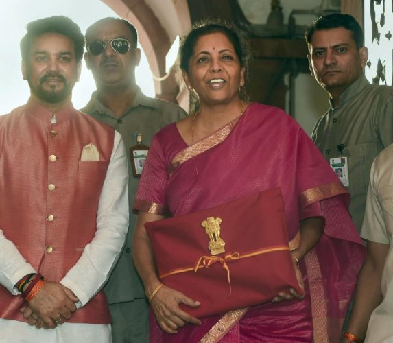 Finance Minister Nirmala Sitharaman and MoS Anurag Thakur arrive at Parliament to present the Union Budget 2019-20, in New Delhi, Friday, July 05, 2019. PTI Photo