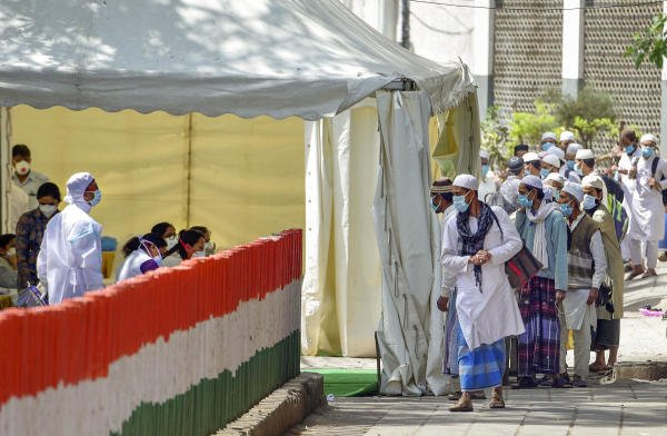 People who came for 'Jamat', a religious gathering at Nizamuddin Mosque, being taken to LNJP hospital for COVID-19 test, after several people showed symptoms of coronavirus, during a nationwide lockdown, in New Delhi, Tuesday, March 31, 2020. (Credit: PTI Photo/Vijay Verma)