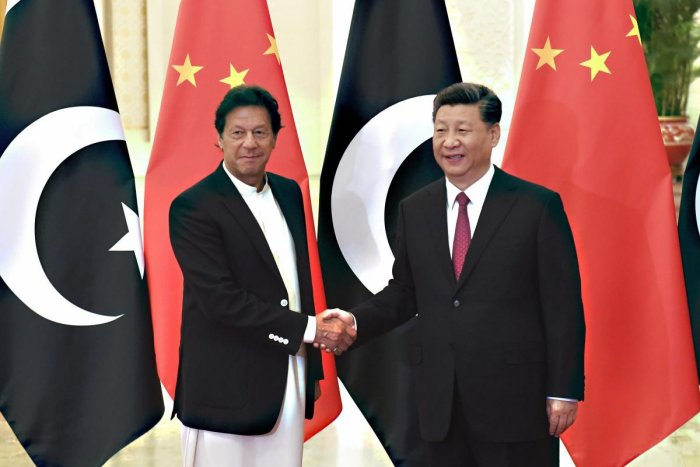 China's President Xi Jinping shakes hands with Pakistan's Prime Minister Imran Khan before a meeting at the Great Hall of the People in Beijing, China April 28, 2019. Photo/Reuters