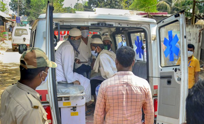An ambulance carries devotees, who had recently attended the religious congregation at Tabligh-e-Jamaat's Markaz in Delhi's Nizamuddin area. (PTI Photo)
