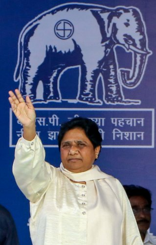 BSP supremo Mayawati waves at party workers at an election campaign rally in support of party candidates ahead of Maharashtra Assembly polls, in Nagpur. (PTI Photo)