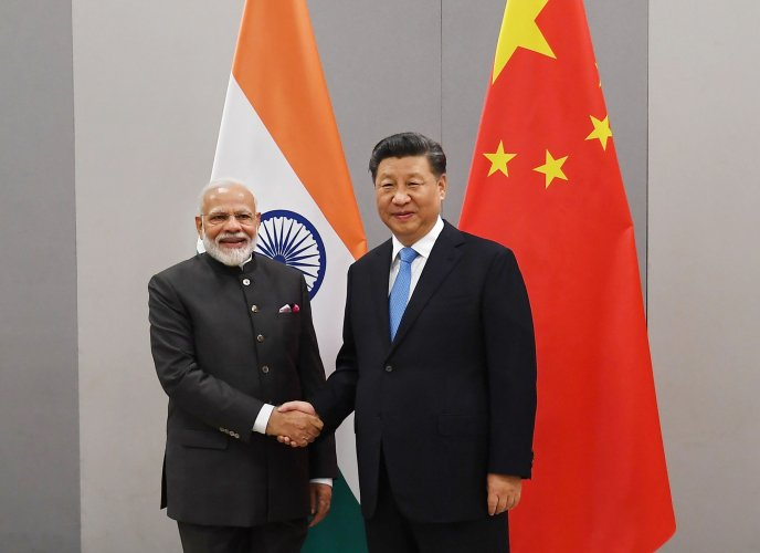 Prime Minister Narendra Modi shakes hands with Chinese President Xi Jinping. (PTI Photo)