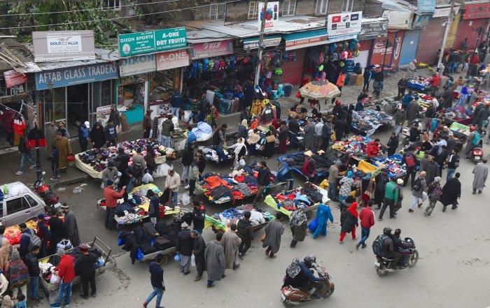 People shop at a market, in Srinagar. (PTI Photo)