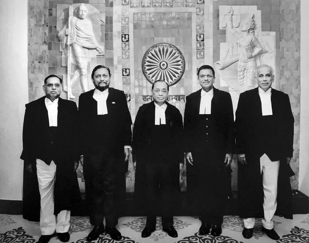 A group photo of the five-judge bench comprised of Chief Justice of India Ranjan Gogoi (C) flanked by (L-R) Justice Ashok Bhushan, Justice Sharad Arvind Bobde, Justice Dhananjaya Y Chandrachud, Justice S Abdul Nazeer after delivering the verdict on Ayodhya land case, at Supreme Court in New Delhi. (PTI Photo)