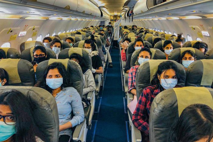Sri Lankan students of Lovely Professional University (Jalandhar) board a special chartered plane for their home country, during the nationwide lockdown to curb the spread of coronavirus, in Amritsar. (Credit: PTI Photo)