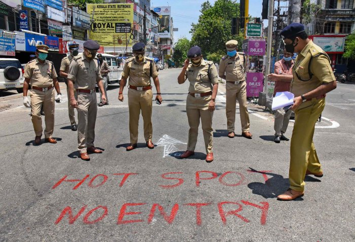 Police personnel mark a locality of Kaloor - Kathrikadavu as a COVID-19 hotspot, following emergence of positive patients, during the nationwide lockdown to curb the spread of coronavirus. (PTI Photo)