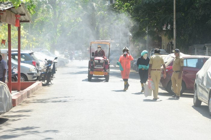 Firefighters sanitise a containment zone, during the nationwide lockdown to curb the spread of coronavirus, in Mumbai. (PTI Photo)