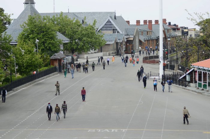 Locals walk along the Ridge during curfew relaxation hours, amid the nationwide lockdown to curb the spread of coronavirus, in Shimla. (Credit: PTI Photo)