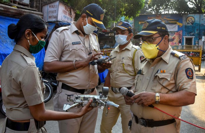 Police manoeuvre a drone to check people's movement during a 21-day nationwide lockdown, a measure to prevent the spread of coronavirus, at a market in Mumbai. (Credit: PTI)