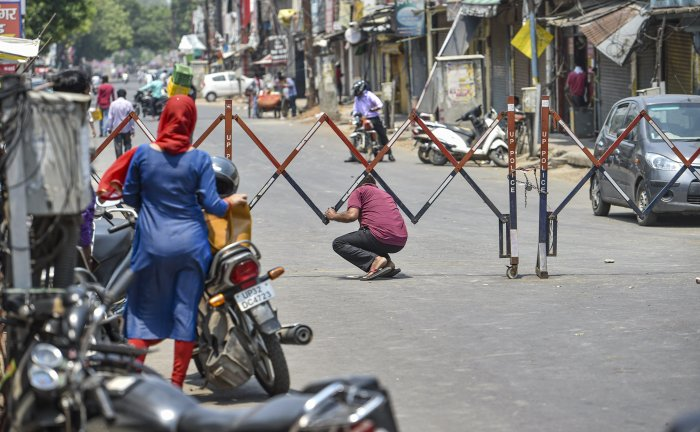 A man attempts to breach a barricade as he violates curfew norms, during the nationwide lockdown to curb the spread of coronavirus. (PTI Photo)