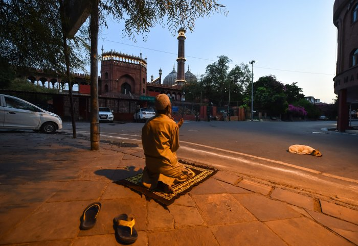 A man offers Namaz near Jama Masjid on the second day of holy month of Ramzan, during a nationwide lockdown in the wake of coronavirus pandemic, in New Delhi. (PTI Photo)