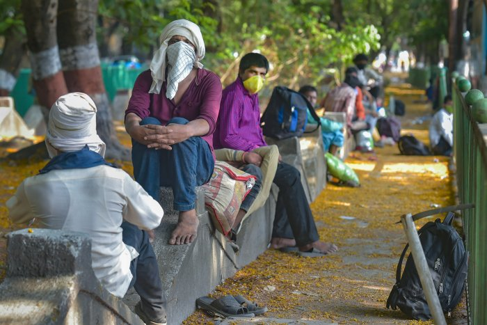 Migrant workers from Lucknow take rest along the Eastern Express Highway on their way to the native places, during a nationwide lockdown in the wake of coronavirus. (PTI Photo)