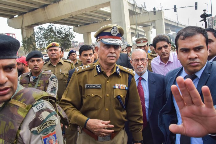 Delhi Police Commissioner S N Shrivastava (C) along with Lt Governor Anil Baijal (C on R) inspects Maujpur Chowk area of the riot-affected northeast Delhi. (PTI Photo)