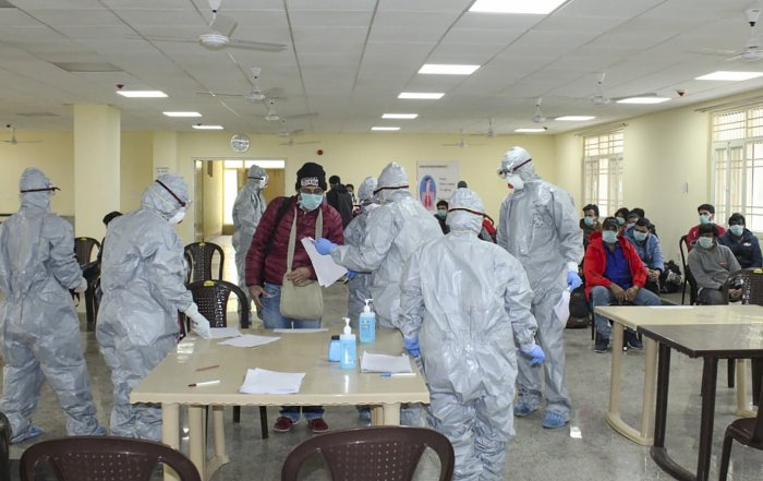 Samples for virus testing being collected at AIIMS hospital, Delhi. (PTI photo)