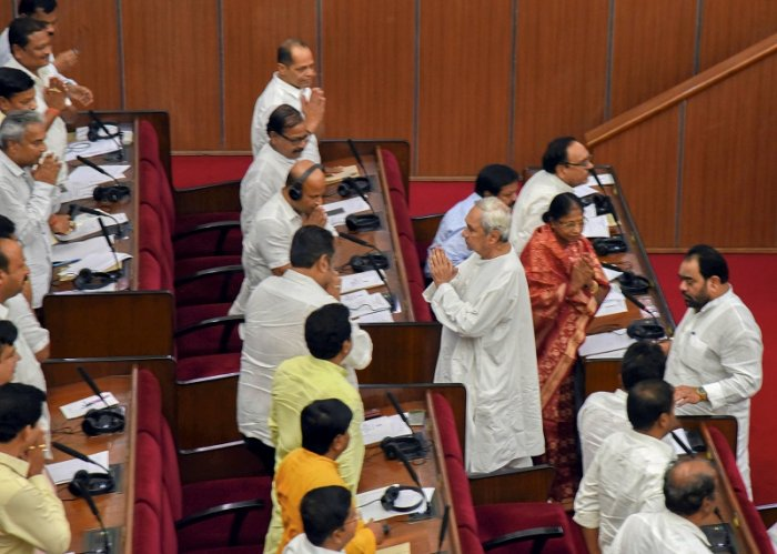 Odisha Chief Minister Naveen Pattnaik greets the members on the first day of the Budget Session of Assembly. (PTI Photo)