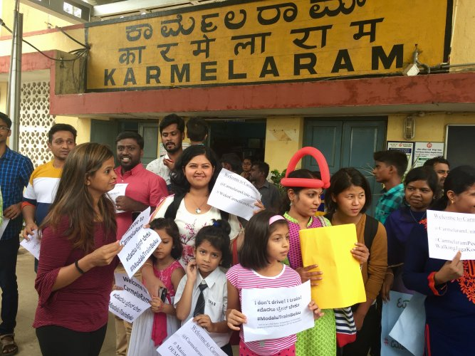 The participants of the rail yatra taken out to raise awareness about the city's rail network board the train at Karmelaram on Friday. DH Photo/Grace Hauck
