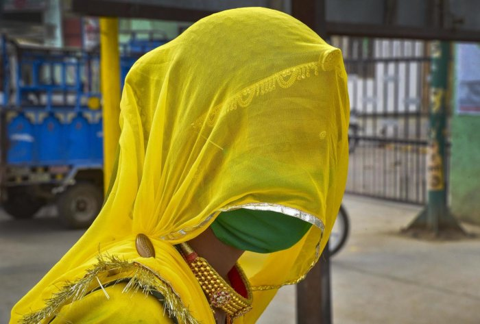 A woman wears a mask in the wake of deadly coronavirus, in Bikaner, Monday, March 23, 2020. Credit: PTI Photo